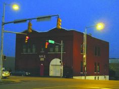 The Firehouse Shelter at night, at its current location on 3rd Avenue North, west of downtown Birmingham. Originally built in 1906, the building has been a homeless shelter since 1983. Those who run the Firehouse Shelter want to build a new and improved version of the building about a mile from the current site. Photo by Tom Gordon.