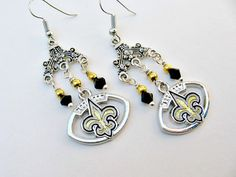 New Orleans Saints Football Earrings by SportsJewelryStudio on Etsy.  etsy.com/shop/sportsjewelrystudio.  $16.50.  #neworleanssaints; #footballearrings; #Etsy