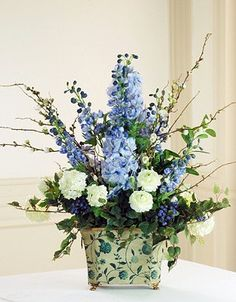 Save yourself a trip to the florist with the permanent display of the lifelike Williamsburg Delphinium Floral Arrangement- perfect for a welcoming entry hall or as a centerpiece on an elegant dining table.