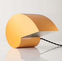 """""""The Snail"""" table lamp in yellow lacquered metal. Designed by G. Raimondi for Studioluce, Italy, circa 1970."""