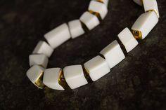 Porcelein necklace with gold glaze by Anna Kiryakova.