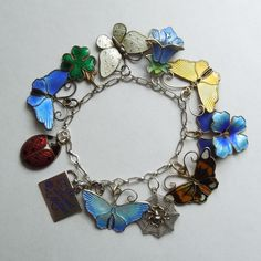 Garden bracelet made for my mom with big enamel charms and pendants, mostly Scandinavian/David-Andersen.