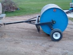 Lawn RolleHomemade lawn roller constructed from a surplus propane tank, steel tubing, bearings, and wheelsr