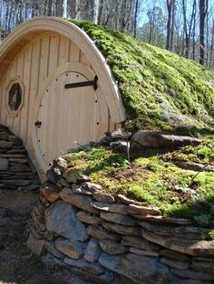 Hobbit Hole Cottage - Installed with a moss roof covering. Landscaping by Wooden Wonders.