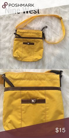 Nine West Crossbody Purse Great crossbody purse! It is made from nylon and is a beautiful yellow color! Works great for a pop of color and will be perfect for the upcoming spring and summer seasons. Has minor scuffs along the bottom edge but other than that is in perfect condition. Nine West Bags Crossbody Bags