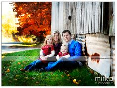Fall family photography - sitting in front of barn, posing idea-wearing reds and blues