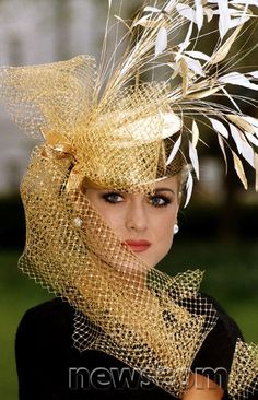 <3 <3 <3 Fashion Hats by Philip Somerville A gold hat with gold netting modelled by Helen Fairbrother