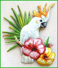 "Metal art parrot wall decor. Tropical art - Painted metal art cockatoo – Tropical Decorating - Tropical Design - Tropical wall decor - Caribbean decorBeautifully hand painted metal wall hanging.Very detailed white cockatoo parrot wall art. Painted on recycled steel drum in Haiti. A hanger is on the back.    Cockatoo wall art measures 21"" x 24"". #tropicaldecor  #outdoorwallart  #gardendecor   #metaldecor #tropicalart #parrots #tropicalbirds"
