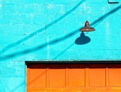 Electric Aqua building orange door Art Print