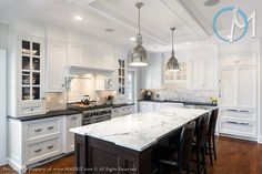 Gorgeous kitche with absolute black granite. Love the island details and the fridge!!