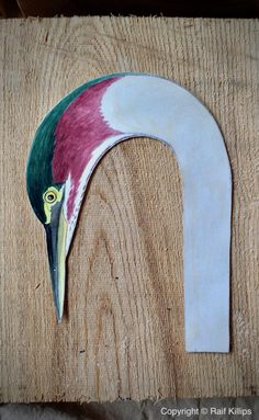 Painted paper carving profile on top of ash carving blank