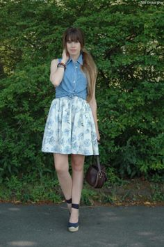 Love the denim top over the cute dress