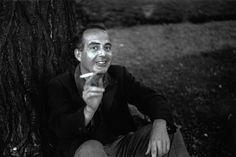 Samuel Barber smoking under a tree.