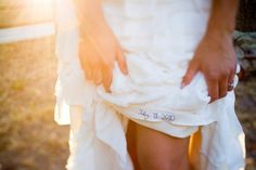 Embroidering a wedding date into a dress is a sweet touch and a very subtle way to wear something blue.