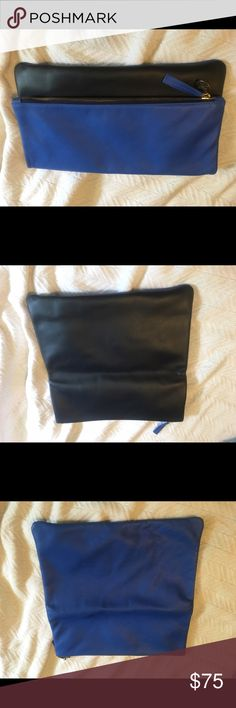 Clare V fold over clutch - royal blue and black Clare V fold over clutch in royal blue and black. Soft leather and goes with any outfit! NWOT Clare Vivier Bags Clutches & Wristlets