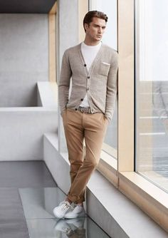 Shop this look on Lookastic: http://lookastic.com/men/looks/crew-neck-t-shirt-cardigan-belt-chinos-low-top-sneakers/8640 — White Crew-neck T-shirt — Grey Cardigan — Grey Leather Belt — Khaki Chinos — White Low Top Sneakers