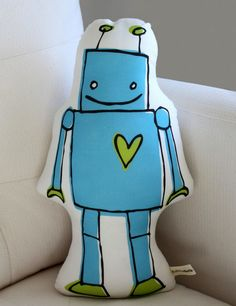 Back ordered until December 30th. Robot Pillow from Little Korboose! Size: 13 x 9. Sophisticated light-weight canvas woven from 55% linen and 45%
