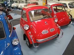"1957 BMW Isetta 300 export. This Isetta is special for 2 reasons: 1: It is the only ""Export"" model on display. 2: It is famous!  As part of the collection dragged from the swamps in Florida, restored. When the original collection was sold at Christie's Auction House in London in March 1997, it set a record high price for the sale of a BMW Isetta.  News of this traveled around the globe and after that the prices of Isettas skyrocketed as suddenly it was OK to collect them as they had some…"