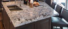 I almost never like granite, but this island top is gorgeous! Graniteworks, Bianco Antico Granite Countertop