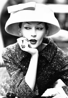 Dovima wearing cloche by Balenciaga. Photo taken by Avedon at Cafè des Deux Magots, August 1955.