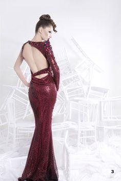 Fabulous Nicolas Jebran asymetrical burgundy gown.