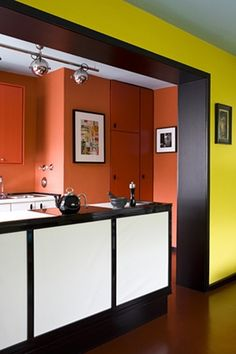 beautiful, warm orange walls contrast against the yellow of the adjoining room. Turbulence Deco, Small Apartment Design, Room Paint Colors, Bespoke Kitchens, Home Decor Inspiration, Color Blocking, Colour Block, Decoration, Kitchen Design