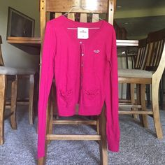 Hollister Pink Cardigan This sweater is like new. The pockets have really cute fluffy material on them and the pockets and buttons have a velvet trim. It's very soft. Hollister Sweaters Cardigans