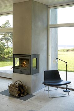 20 cozy corner fireplace ideas for your living room, Concrete interior Home Fireplace, Fireplace Design, Concrete Fireplace, Fireplace Ideas, Inset Fireplace, Cottage Fireplace, Concrete Wall, Scandinavian Fireplace, Scandinavian Cottage