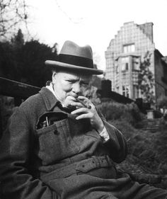 Winston Churchill smokes a cigar at his Kentish home, Chartwell, in 1947.