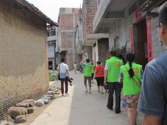 Many volunteers in the green vests went with us to visit the children. They are from the Wuxuan Welfare Charity.