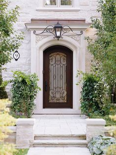 Create a polished and sophisticated entry by choosing the same color or metal finish for exterior elements such as entrance hardware, door knockers, house numbers, mailboxes, and porch lights. Door would not work for our house but it sure is beautiful. Gates, Home Staging Tips, Entrance Doors, Doorway, Door Entry, Grand Entrance, Cool Doors, Front Entry, Portico Entry