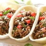 These beef Barbacoa Tacos are cooked in the slow cooker all day so you can come home to savory and spicy tacos. I love barbacoa meat and these Barbacoa Tacos are a crowd pleasing Mexican Mexican Dishes, Mexican Food Recipes, Dinner Recipes, Ethnic Recipes, Mexican Meals, Slow Cooker Recipes, Crockpot Recipes, Cooking Recipes, Delicious Recipes