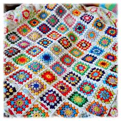 My finished crochet blanket. Summer Garden granny square inspired.