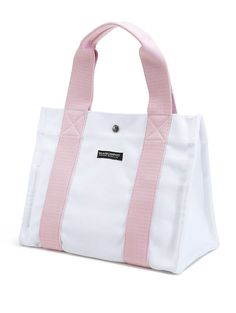 Our Small Pink Island Tote is great for island days on the go.  Fit all the necessities for a busy day to an evening out in this durable canvas tote.