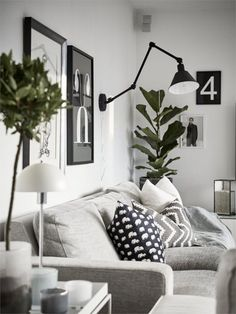 Modern scandinavian living room with gray interior. Wall art and green plants. Modern scandinavian living room with interior in gray. Wall art and green plants. The post Modern Scandinavian liv Scandinavian Interior Design, Scandinavian Living, Gray Interior, Home Living Room, Interior Design Living Room, Living Room Designs, Living Room Decor, Small Living Room Layout, Small Living Rooms