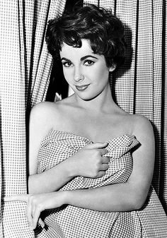 ELIZABETH TAYLOR on the set of Rhapsody, (1954) By: Ruth Harriet Louise
