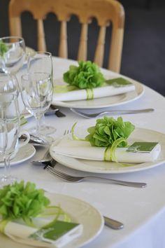 Pistachio green napkin pom poms available from www.wedding-workshop.co.uk