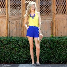 Fashion Inspiration: Coordinate cobalt blue pleated shorts with a bold yellow top. Add a bold cobalt blue statement necklace to tie the color-blocking outfit together.