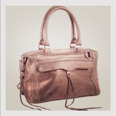 MAKE OFFERRebecca Minkoff MAB bronze&rose gold Large MAB - stunning bronze metallic handbag with rose gold hardware. Tons of pockets, zippered space, and can be worn on the shoulder, cross body, or held by the smaller straps. Comes with duster bag. Rebecca Minkoff Bags Crossbody Bags