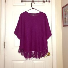 Purple Dolman Sleeve Sweater Oversized dolman sleeve short sleeved sweater. Scoop neck. Tassels around the bottom edge. Size women's large. NY Collection Sweaters Shrugs & Ponchos
