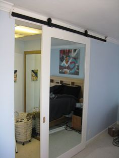 Charming Admirable White Stained Wood Contemporary Sliding Barn Door Closet With  Mirror Feature Big Mirror On Sliding Door And Black Metal Oil Rubbed Bronze  ...