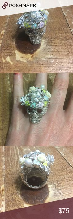 Betsey Johnson swarovski crystal Skull Ring. Gorgeous detail on this ring. Never worn. It is decked out with pastel colored flowers and pearls. Not so eager to part with it so make me a good offer if you want it. It is a size 7 but has an adjustable inner area (see picture). Betsey Johnson Jewelry Rings
