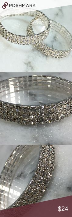 "Set of 2 Silver Crystal Stretch bracelets. Set of 2 Silver Crystal Stretch Bracelets. Perfect for a glamorous night out or event!  Beautiful sparkling accessories feature a stretch core so that one size fits most. 3 rows of crystals; bracelets are ½"" wide with 3 rows of crystals. Jewelry Bracelets"