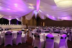 LED uplighing, ceiling draping, chandelier, www.eventsmadeexclusive.com Fredericton wedding and event decor