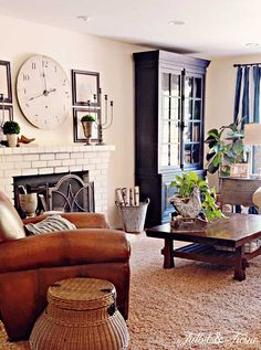 Casual family room - love all of the different tones and textures eclecticallyvintage.com Check out the cupboard.
