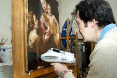 "Restoration and conservation are the focal points of our mission. Here, an art restorer is at work on Titian's ""The Madonna and Child with Saint Catherine of Alexandria,"" which dates from 1550 to 1560."