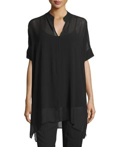 Eileen Fisher sheer silk georgette tunic. Available in your choice of color. Stand collar; V neckline. Short sleeves. Relaxed silhouette. Arched hem; side vents. Pullover style. Silk; dry clean. Impor