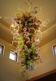 "This chandelier sculpture by Dale Chihuly was designed to represent the desert's region such as cactus, snakes, lizards, and horns of the bighorn sheep. The artist carefully selected both intense and delicate hues of green, purple, amber, and sand to indicate the desert landscape. The sculpture is 12 feet high and 6 feet in diameter and is suspended 23 feet above the floor."" (Palm Desert, CA)"