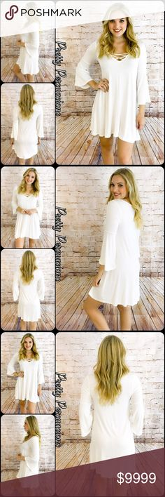"""3 LEFT‼️ Strappy V-Neck Bell Sleeve Jersey Dress NWT White Lace Up V-Neck Bell Sleeve Jersey Shift Dress  Available in S, M, L Measurements taken from a small  Length: 34"""" Bust: 36"""" Waist: 38""""  Rayon/Spandex Made in the USA  Features  • lace up detailing  • rounded v-neckline  • bell sleeves • relaxed, easy fit • soft, jersey material w/stretch  Bundle discounts available  No pp or trades  Item # 1/102100390WBSD white lace up bell sleeves Pretty Persuasions Dresses"""