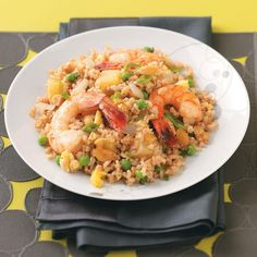 Shrimp and Pineapple Fried Rice Recipe -Pineapple chunks give fried rice a tropical twist, while shrimp and cashews turn this simple favorite into a restaurant-quality meal everyone will love. —Lynne Van Wagenen, Salt Lake City, Utah